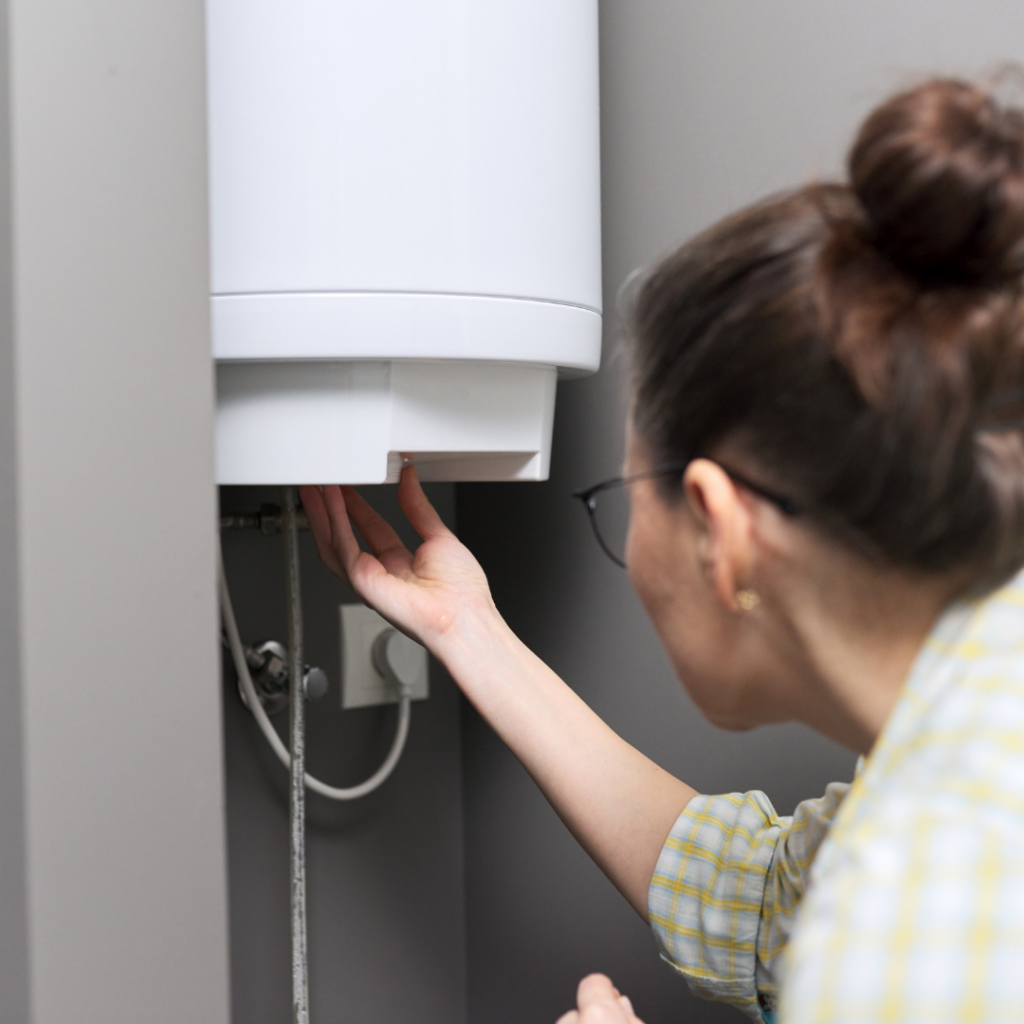Woman Changing Water Heater Temperature